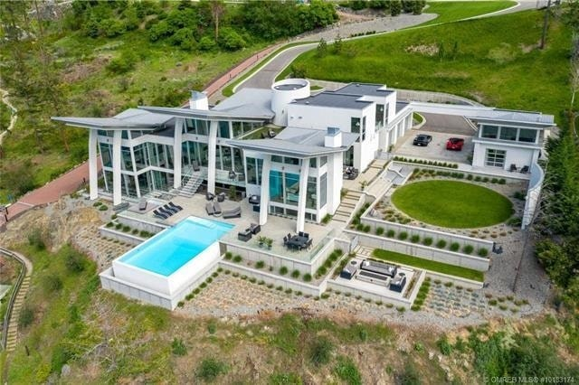 The sprawling house from above, revealing its landscaped terraces. Listing agent: Richard Deacon