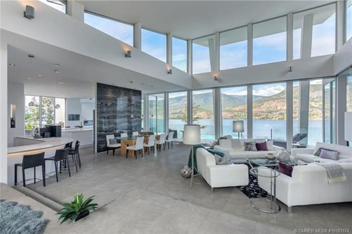 The great room has vaulted ceilings and massive windows to make the most of those epic lake views. Listing agent: Richard Deacon