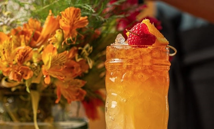 Tropical drinks are also featured, including the Punch Drunk cocktail. Photo: @h2restaurant