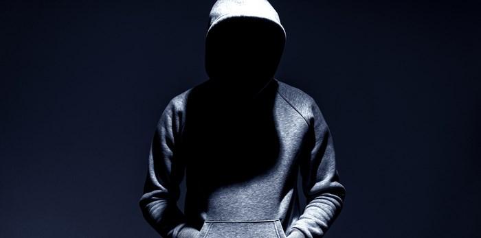 Unknown man in hoodie/Shutterstock