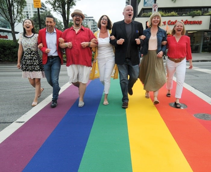 From left: City of North Vancouver Couns. Tina Hu and and Tony Valente, North Shore Pride Alliance co-founder Gary Fluffer Woods, Mayor Linda Buchanan, Alliance co founder Chris Bolton, and Couns. Jessica McIlroy and Angela Girard make the first crossing of the first rainbow crosswalk in the City of North Vancouver, Friday morning. Photo by Mike Wakefield/North Shore News