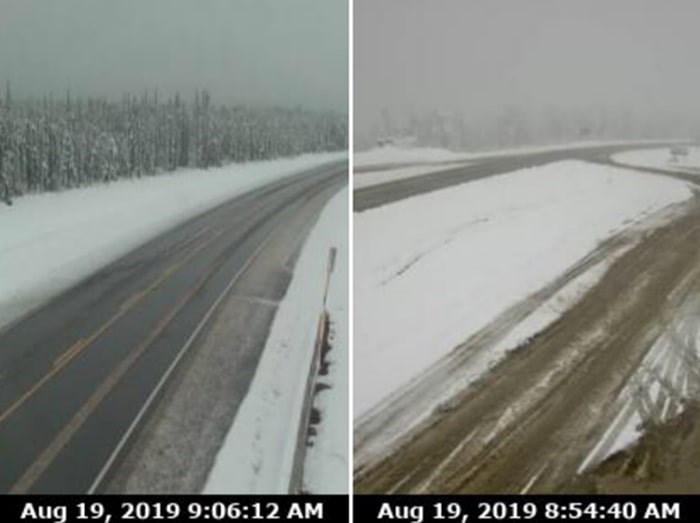 Highway 97 near Fort Nelson, Steamboat Hill (left) and Sikanni Chief, are covered in snow during unusual weather patterns in the middle of August 2019 (via Drive B.C./Kyle Balzer)