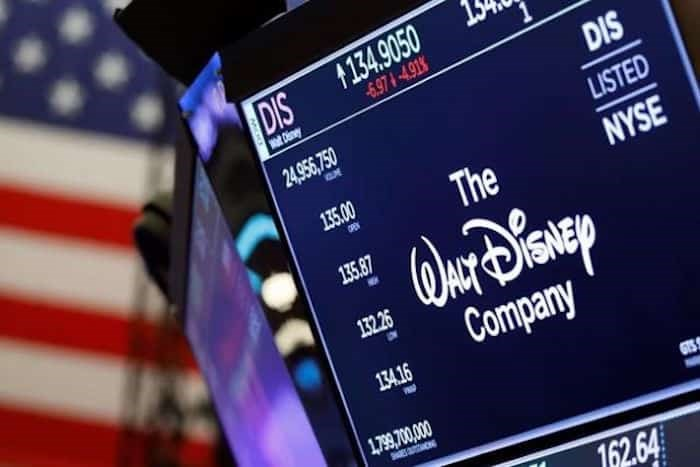 The logo for The Walt Disney Company appears above a trading post on the floor of the New York Stock Exchange, Wednesday, Aug. 7, 2019. Photo: The Canadian Press