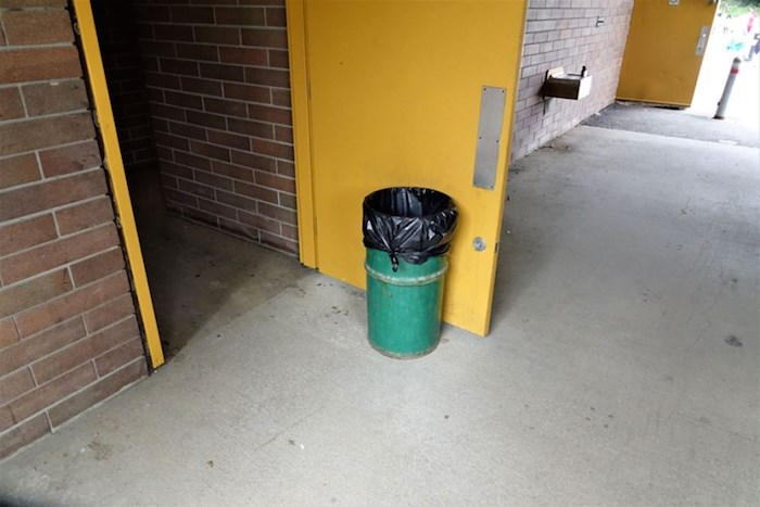 A City of Burnaby garbage can propping open a door at Deer Lake. Photo courtesy John Preissl