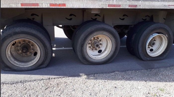 The Delta police traffic unit pulled over a truck Tuesday morning with six flat tires and a cracked tire rim. Photo courtesy Delta Police Traffic Division