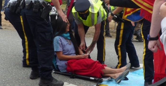 This photo of Rita Wong being arrested is posted on the