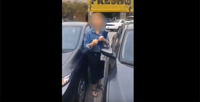 In a video that went viral on WeChat, a Chinese social media platform, a woman is seen yelling racial slurs in a Richmond parking lot.
