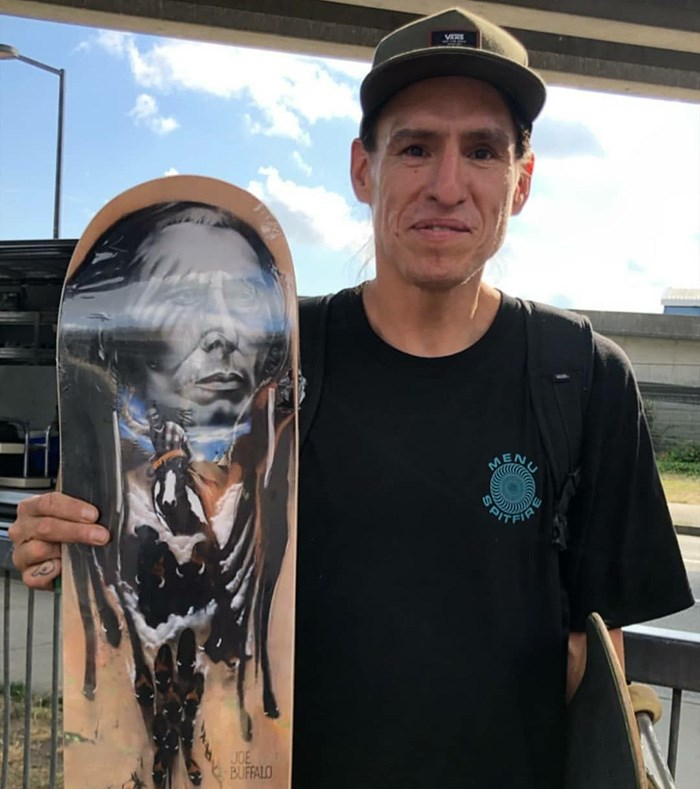 Professional skateboarder Joe Buffalo holds his first pro model for Colonialism Skateboards. Photo provided