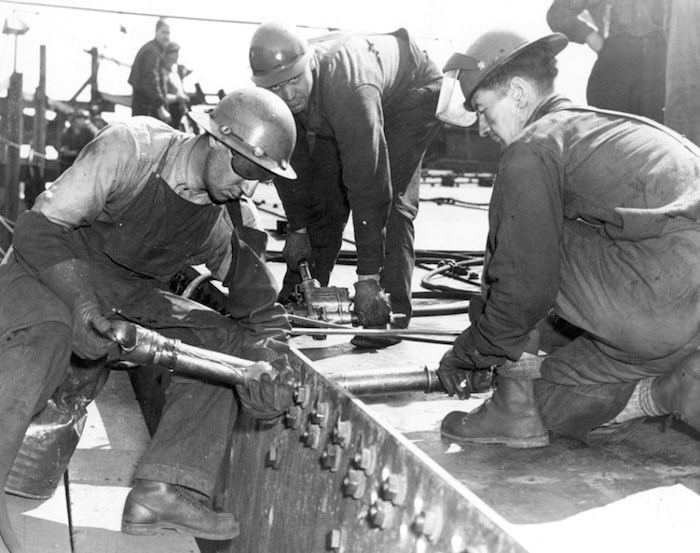 Riveters work on one of the Second World War victory ships on the North Vancouver waterfront. Photo courtesy North Vancouver Museum and Archives