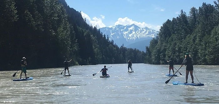 A new company called Mountain Beaver Adventure Co has launched an epic SUP and SIP tour in Pemberton. Photo: Mountain Beaver Adventure Co.