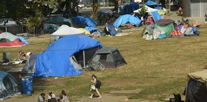 Homeless people remain in Oppenheimer Park while Mayor Kennedy Stewart calls for park board to delegate jurisdiction to the city. Photo: Dan Toulgoet