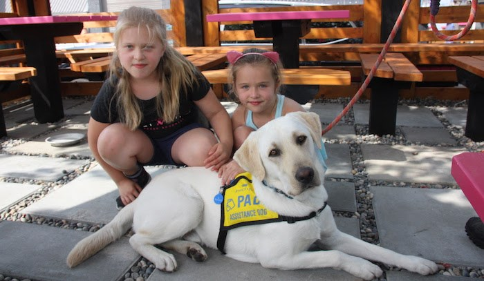 Jules, left, and Gabi, with a PADS dog. Gabi & Jules is holding a fundraiser event in Port Moody on Sun. Sept. 8, 2019. Photo courtesy Gabi & Jules
