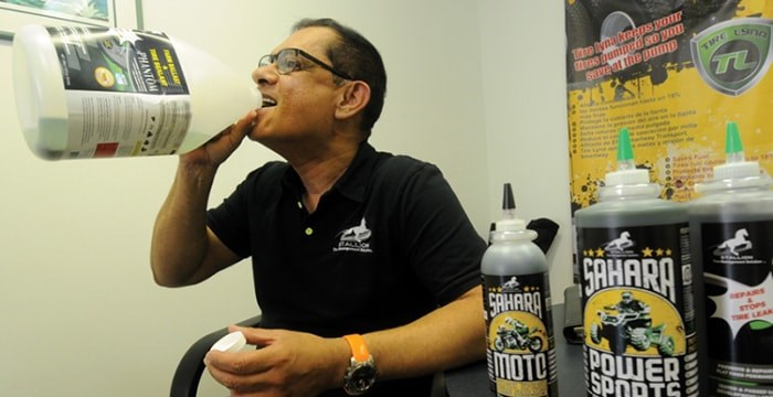 Entrepreneur Noorez Devraj says he was unfairly targeted by the District of North Vancouver after being fined for dumping diluted tire sealant in a back alley drain. In a bid to prove his sealant is non-toxic, Devraj recently helped himself to a drink. photo Mike Wakefield, North Shore News