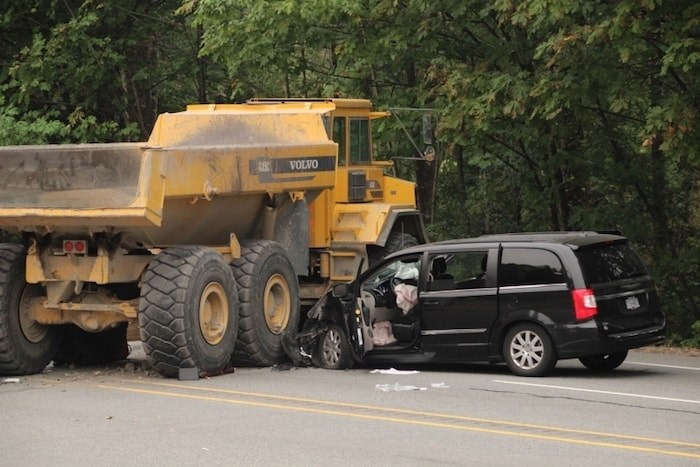 In 2017, an unoccupied dump truck rolled down a hill from a Riverview job site and onto Lougheed Highway in Coquitlam, killing the driver as he jumped out of the truck and a passenger in another vehicle. Photo by Shane Mackichan/Tri-City News