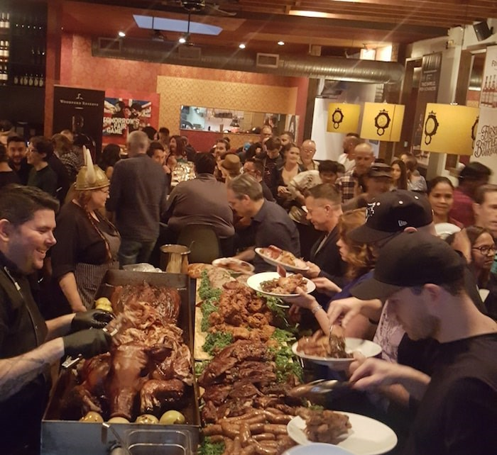 Loading plates at Barbarian's Feast. Photo courtesy The Cascade Room