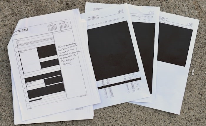 FOI documents with information redacted. Photo by Dan Toulgoet/Glacier Media