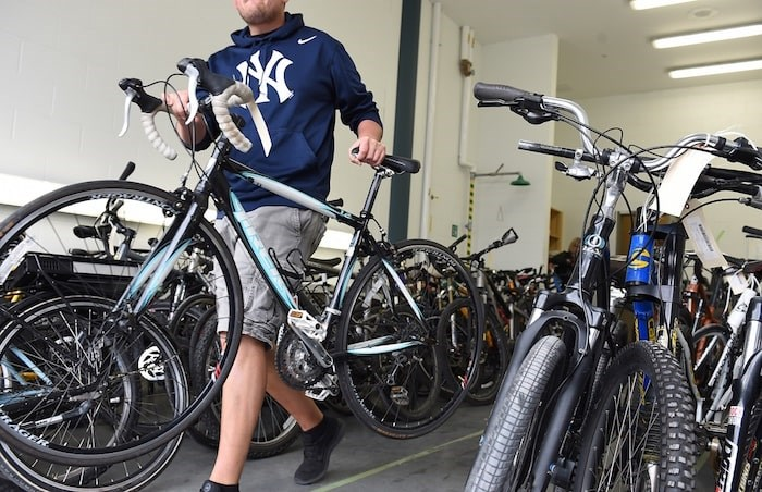 Nearly 150 bikes were recovered from a storage facility in the 800-block of Powell Street and four men were arrested at the scene. They've all since been released without charges. Photo Dan Toulgoet