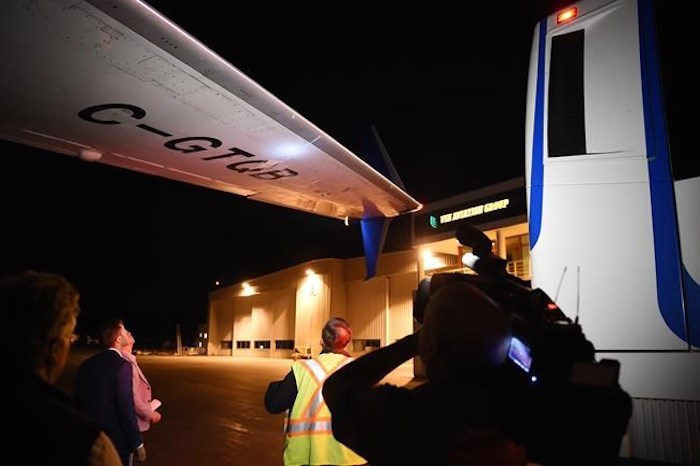 Members of the media inspect the wing from Liberal Leader Justin Trudeau's campaign plane after being struck by the media bus following landing in Victoria, B.C., on Wednesday, Sept.11, 2019. THE CANADIAN PRESS/Sean Kilpatrick