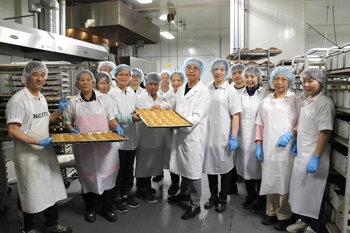 Mickey Zhao (centre right), and the Saint Germain Bakery team preparing the last batch of traditional mooncakes before the Mid-Autumn Festival. Photo by Valerie Leung/Richmond News