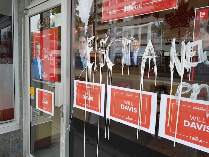 Vandals - who are clearly no fans of Prime Minister Justin Trudeau - smeared white paint on the windows of New Westminster-Burnaby Liberal candidate Will Davis overnight. It's the second act of vandalism at the office in a week. Photo contributed