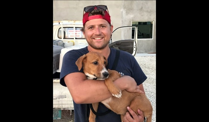 Burnaby firefighter Scott Murchison has signed up to adopt this puppy rescued after Hurricane Dorian in the Bahamas.