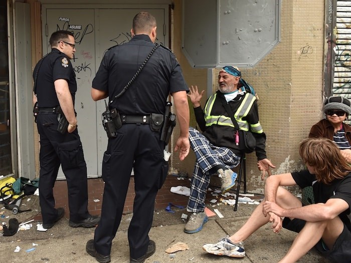 Vancouver police, seen here during the closure of the Balmoral Hotel last year, are accused of creating barriers for drug users to access overdose prevention sites in the Downtown Eastside. Photo by Dan Toulgoet/Vancouver Courier