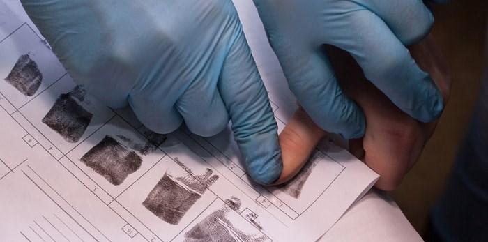 Crime suspect has fingerprints taken/Shutterstock