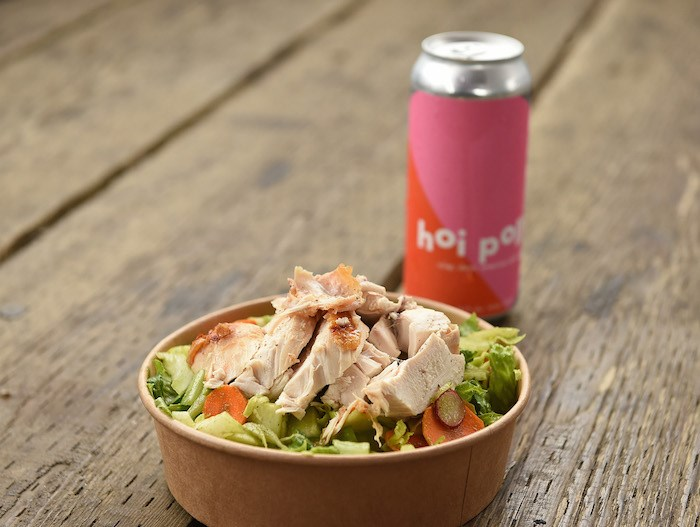 Robert Belcham of Popina's beercan chicken and salad with a Hoi Polloi beer. Photo by Dan Toulgoet