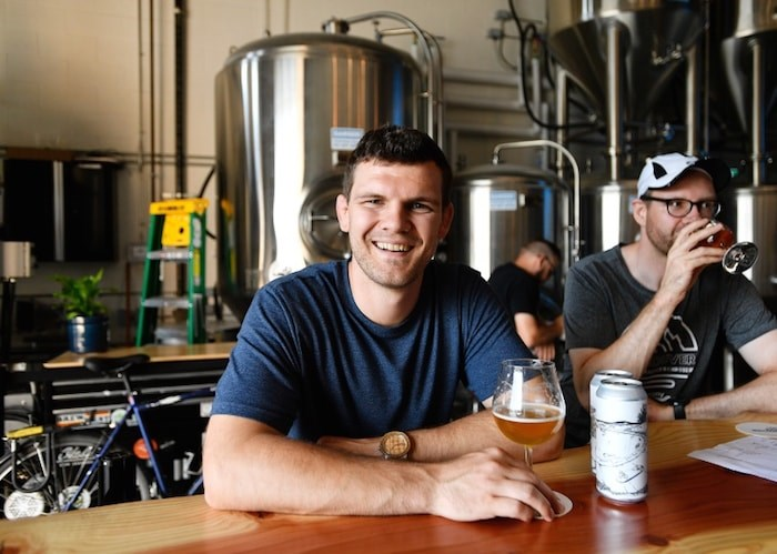 Clete Hanson enjoys a beer at Another Beer Co., the craft brewery he recently opened with Alex Jopson. Photo by Jennifer Gauthier