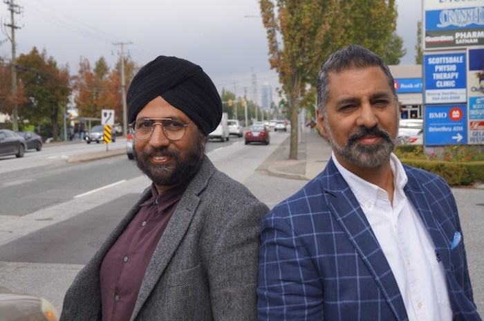 Surrey lawyers Amandeep Singh, left, and Justin Thind, right, support the NDP and Liberals respectively. They spend much of their free time in the office talking politics and see Trudeau's blackface actions as having an impact in Surrey. Photo by Graeme Wood