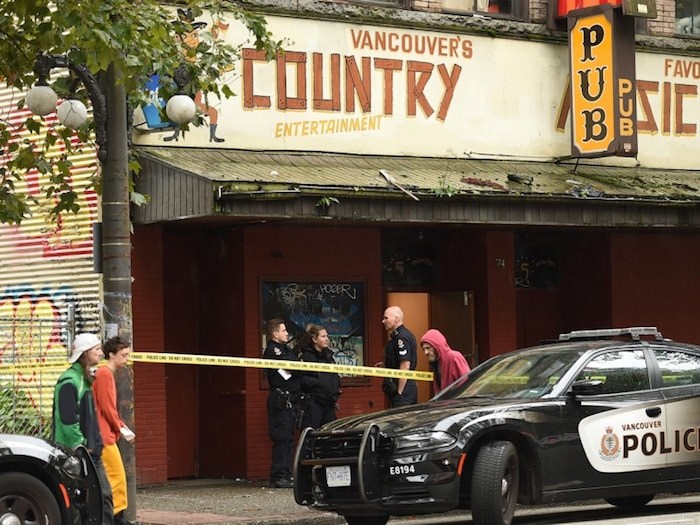 The third of a set of three shootings Sunday into Monday took place at the Grand Union Hotel at 74 West Hastings St. Photo by Dan Toulgoet/Vancouver Courier