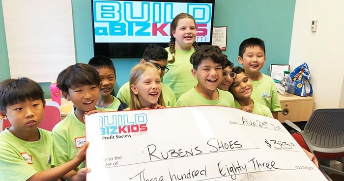 Build a Biz Kids participants with their business earnings. Photo: Build a Biz Kids.