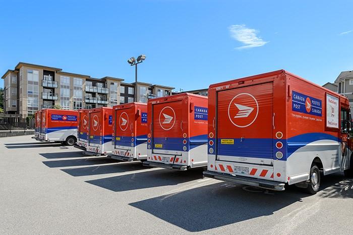 Canada Post trucks in Vancouver. Photo Shutterstock