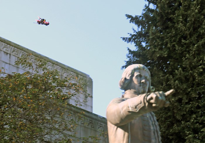 A drone flies behind the statue of George Vancouver at City Hall ahead of the Strike for Climate. Photo Bob Kronbauer