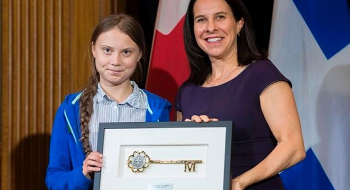 Swedish climate activist Greta Thunberg, left, receives the key to the city from Montreal mayor Valerie Plante during a ceremony in Montreal, Friday, Sept. 27, 2019. THE CANADIAN PRESS/Graham Hughes