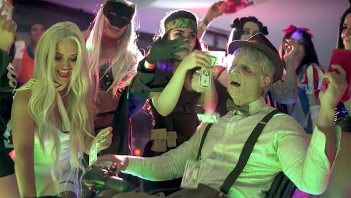 Rees Cameron, right, during a Halloween party at a property he rented on Pacific Street in Vancouver. Last summer, Cameron was one of the organizers of a house party in Anmore that saw multiple helicopter landings and several visits from police. Screenshot/YouTube