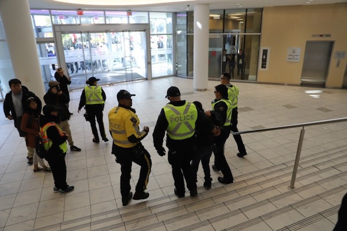 A man escorted away by Richmond RCMP and asked to leave the scene. Photo by Valerie Leung