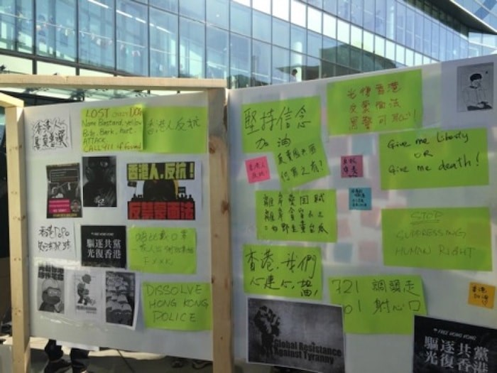 Supporters have placed various sticky notes on the Lennon Wall. Photo by Nono Shen