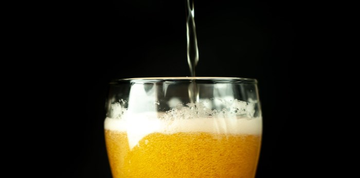 Pouring beer/Shutterstock