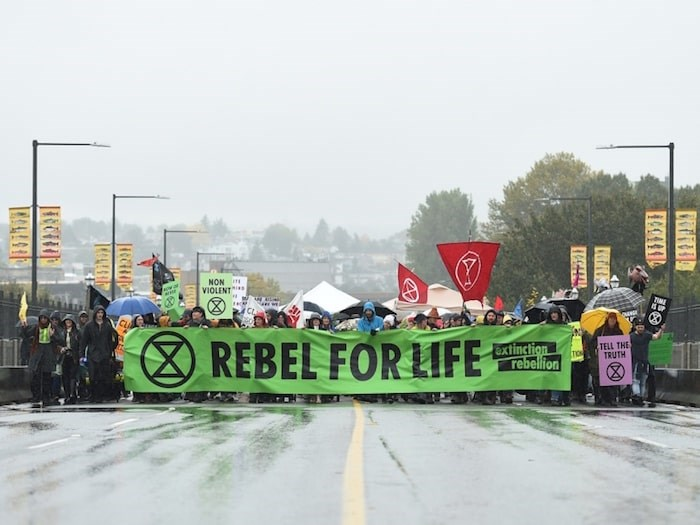 The protest group Extinction Rebellion closed the Burrard Bridge Monday, Oct. 7. They are holding a route-less 'snake march' through downtown Vancouver on Fri. Oct. 18. Photo Dan Toulgoet/Vancouver Courier