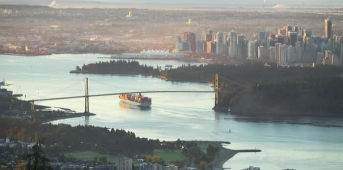 Photo: A high angle view of downtown Vancouver, the Lions Gate Bridge as the sun comes up / Shutterstock