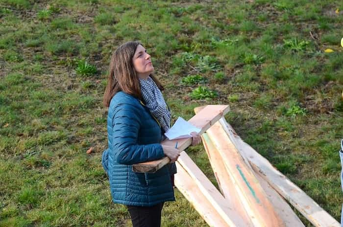 Burnaby heritage planner Lisa Codd records the dimensions of an air-vent pillar for the 106-year-old Alta Vista reservoir in South Burnaby. Photo: Cornelia Naylor