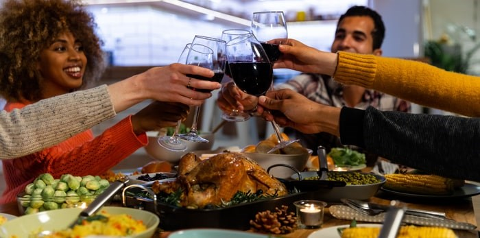 Wondering what wine goes with what? Cheers to this cheat sheet for pairing wines from B.C. with all the holiday meals and gatherings. Toasting over a holiday dinner/Shutterstock