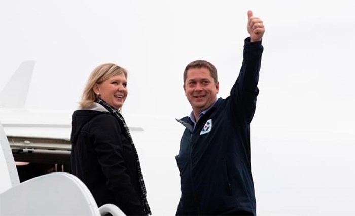 Conservative leader Andrew Scheer gives the thumbs up as he and his wife Jill board the campaign plane in Ottawa, Monday October 14, 2019. THE CANADIAN PRESS/Adrian Wyld