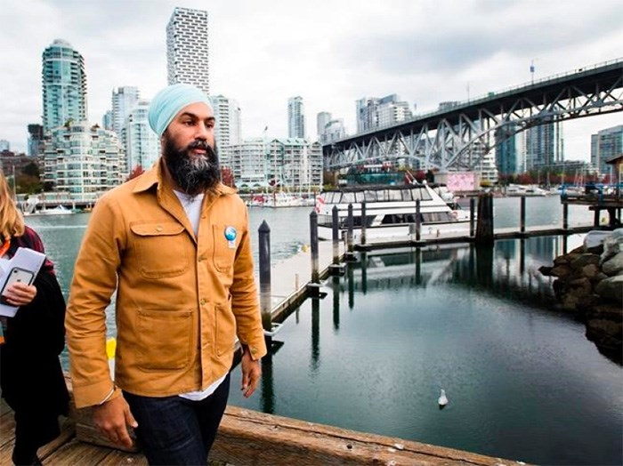 NDP leader Jagmeet Singh leaves the boardwalk after speaking to the media during a campaign stop at Granville Island in Vancouver, B.C., on Monday, October 14, 2019. THE CANADIAN PRESS/Nathan Denette