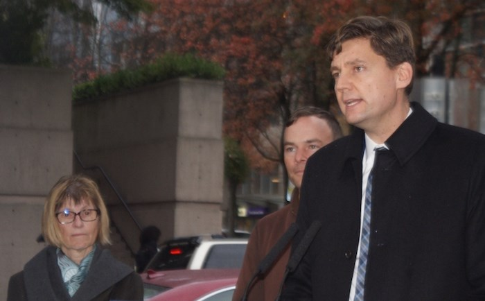 Attorney General David Eby (right) announces a deal with legal aid lawyers as MLA Spencer Chandra Herbert and Legal Services Society chair Jean Whittow look on. Photo by Jeremy Hainsworth/Glacier Media