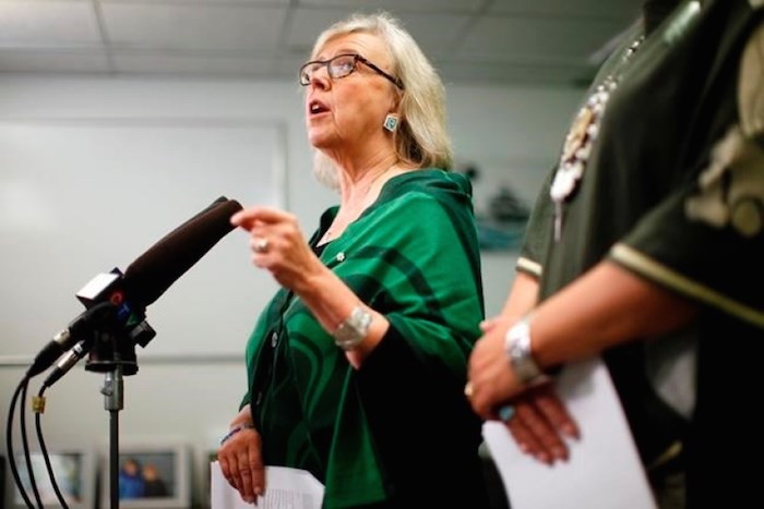 Green Party Leader Elizabeth May announces the Green government will expand the single-payer medicare model to include pharmacare for everyone during a press conference at the campaign office of candidate Racelle Kooy while in Victoria, Wednesday, Oct. 16, 2019. THE CANADIAN PRESS/Chad Hipolito