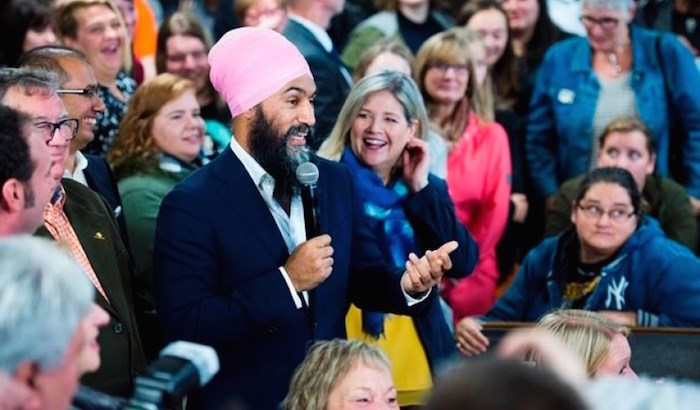 NDP leader Jagmeet Singh, left, and provincial NDP leader Andrea Horwath, right, speak to supporters at the Blue Star diner during a campaign stop in Welland Ont., on Thursday, October 17, 2019. THE CANADIAN PRESS/Nathan Denette