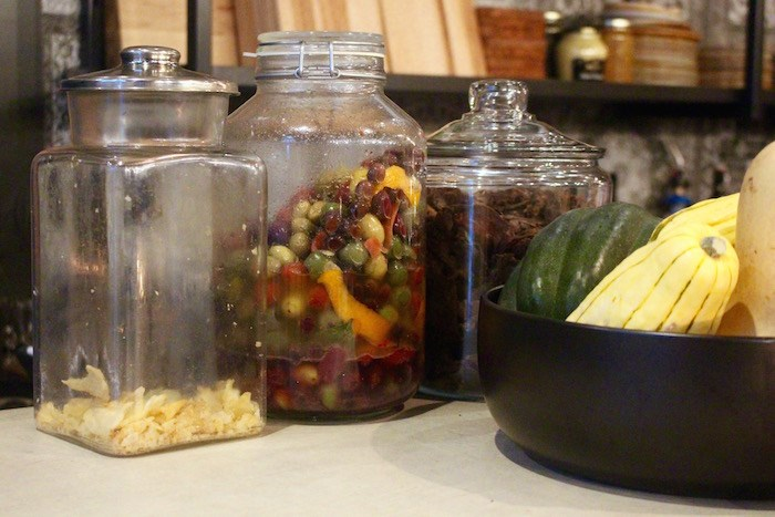 Large jars of olives and other ingredients at the bar. Photo by Lindsay William-Ross/Vancouver Is Awesome