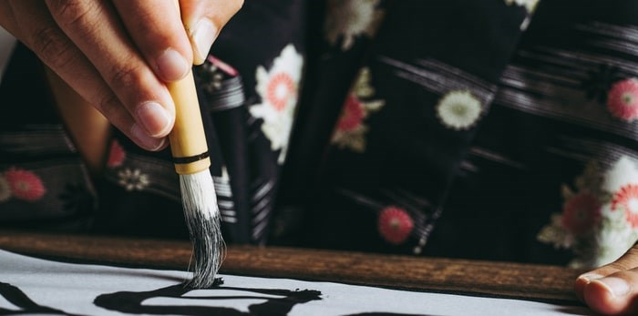Shop for arts and crafts, or take part in a cultural workshop that includes instruction in calligraphy at the Japan Market Vancouver's Christmas Fair. Photo: Japanese calligraphy/Shuttterstock